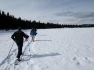 Trekking across a frozen lake.