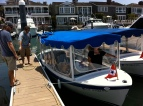 Getting on the electric boat for our harbor cruise with David and Katie.