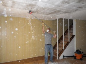 Tim is scraping the popcorn ceiling off. It was a huge mess, but we did it before we moved any furniture in.
