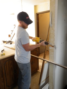 Tim begins to cut the pantry in half to make an island and a more open concept.